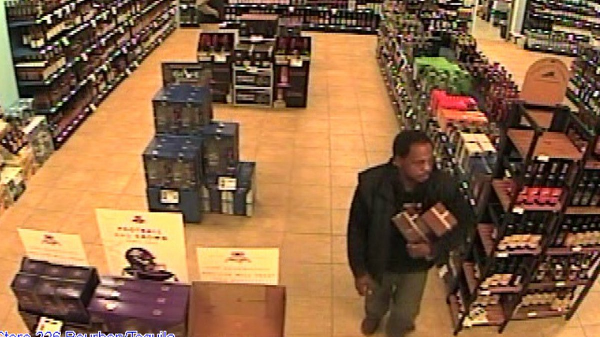 Security footage at an Opelika ABC Beverage store shows a man walking out with two bottles of...