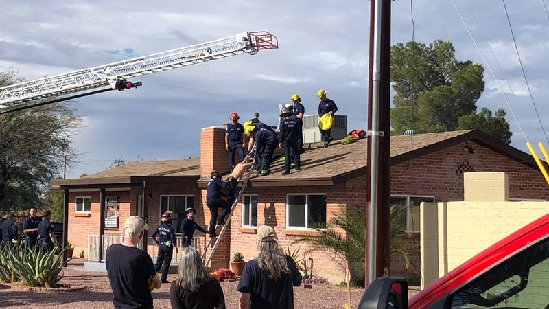 The man was stuck at the bottom of the chimney with his feet sticking out, Tucson first...
