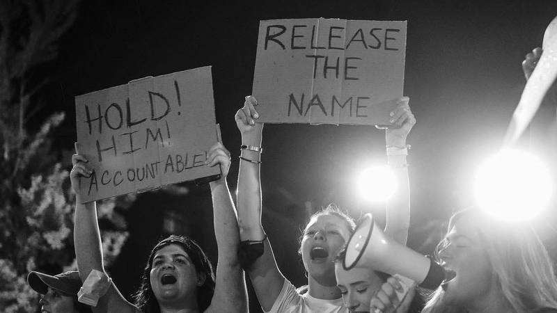 A group of over one hundred students protest at Toomer's Corner after a string of sexual...