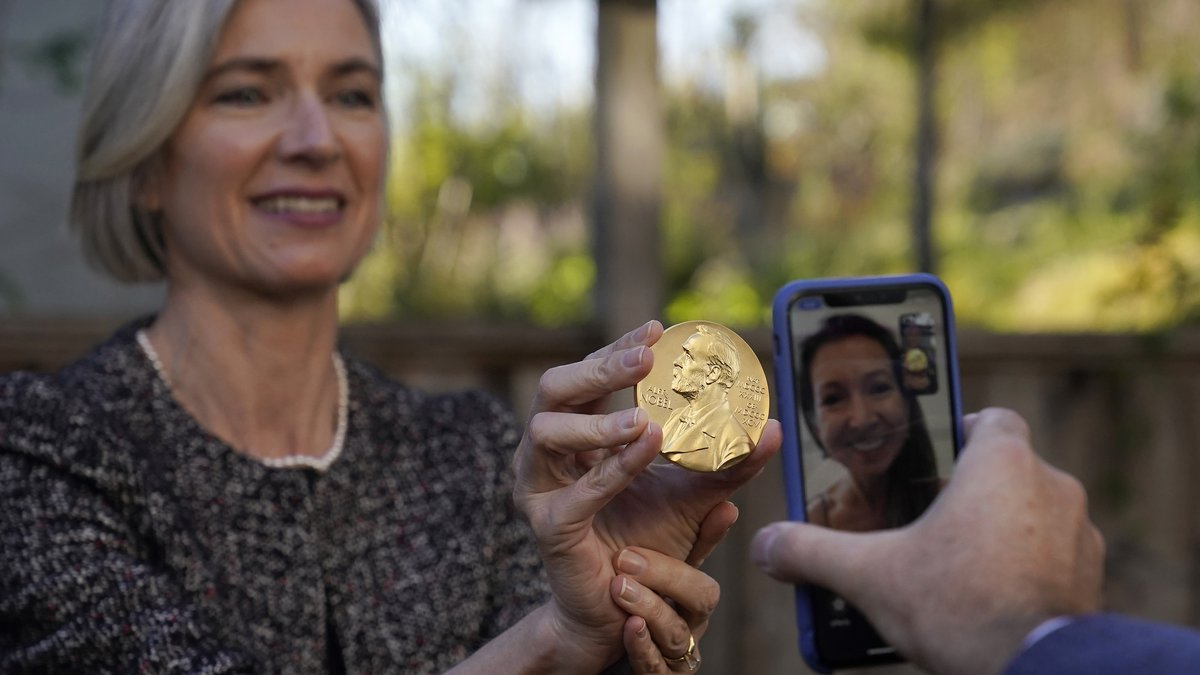 Jennifer A. Doudna holds her Nobel Prize while speaking on the phone to her sister Sarah Doudna...