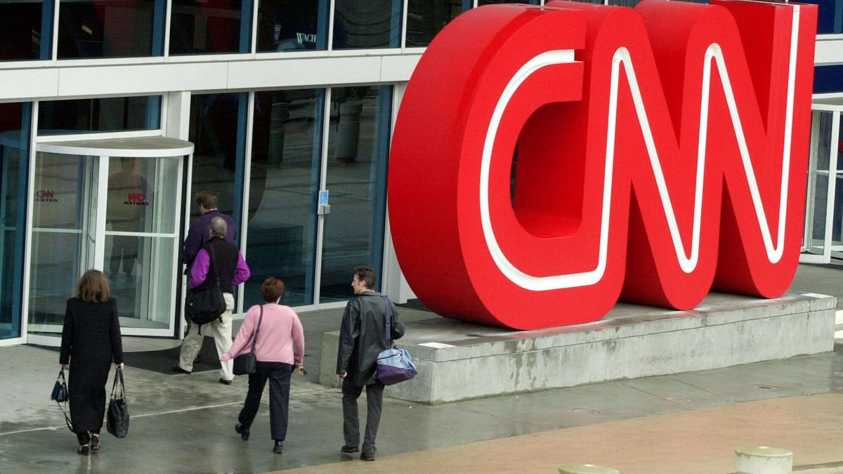 FILE - This Jan. 17, 2001 file photo shows people entering CNN Center, the headquarters for...