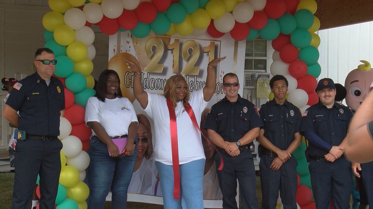 Jackie poses in front of the camera at ribbon cutting event