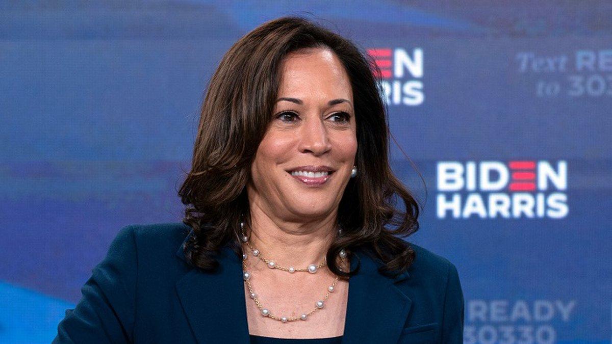 Former Vice President Joe Biden's running mate Sen. Kamala Harris, D-Calif., looks up as she...