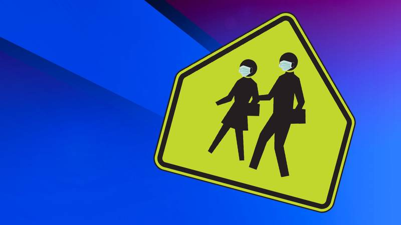 School crossing sign with face masks on students.