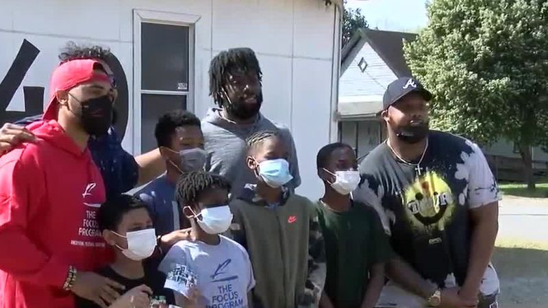 Local football alums return to give back