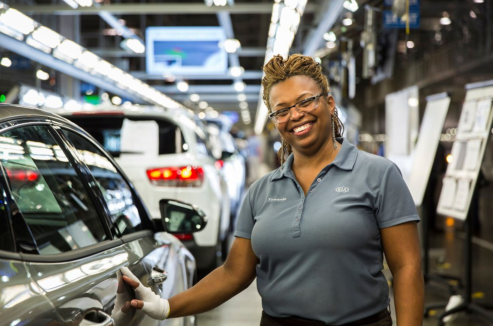 KMMG team members work each day to produce world-class quality products. (Source: Kia Motors...