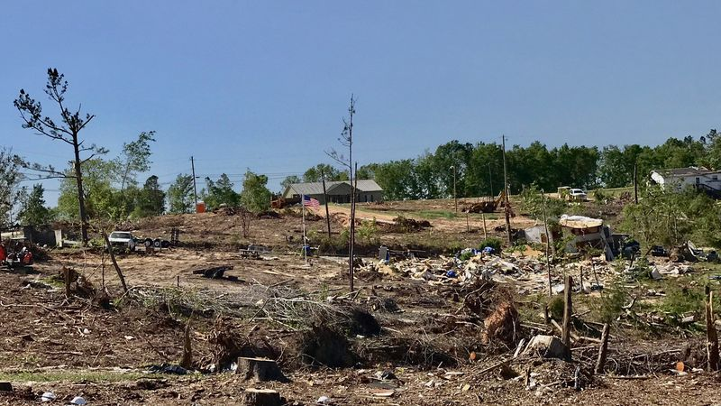 Along County Road 38 homes are unlivable - debris is scattered about. The recovery process is a...