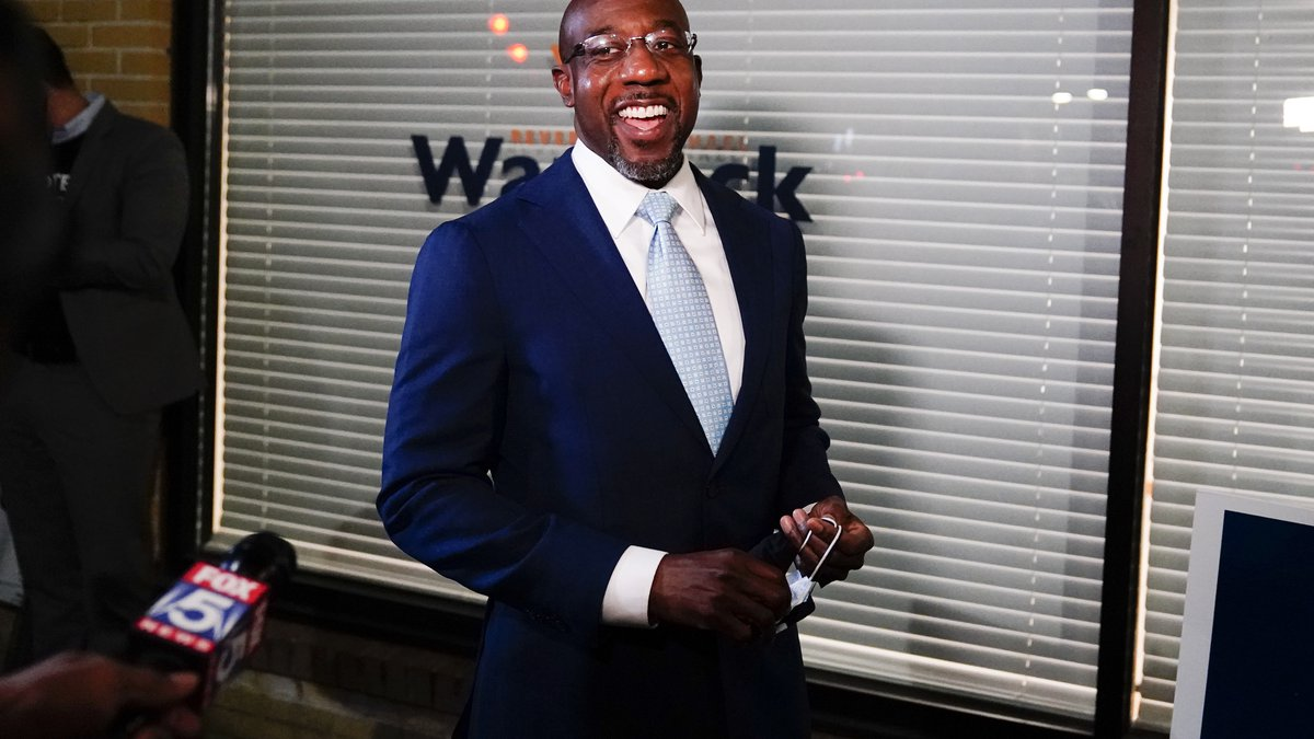 Raphael Warnock, a Democratic candidate for the U.S. Senate speaks to supporters and media...
