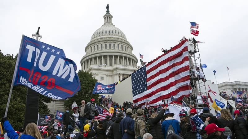 Rioters loyal to then-President Donald Trump outside of U.S. Capitol on  Jan. 6, 2021, in...