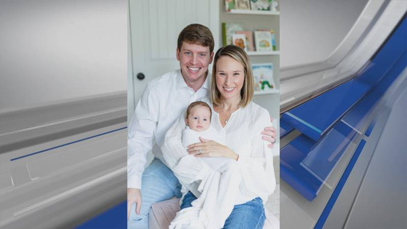 Matthew and Kendall Henderson pose for a photo with baby Lily Ruth.