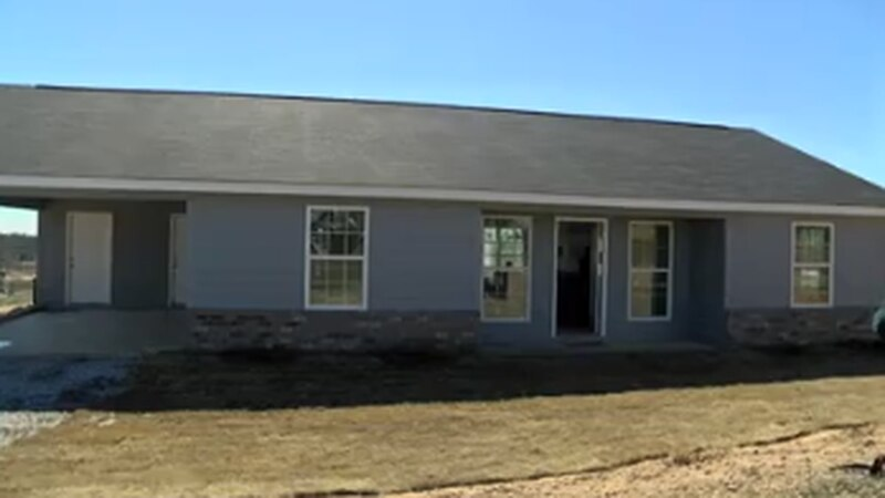 Beauregard woman receives new home two years after husband dies, house destroyed in tornado
