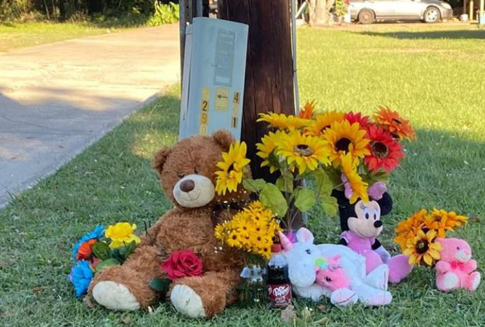 Mourners have created this memorial outside the house in New Boston, Texas, where 21-year-old...