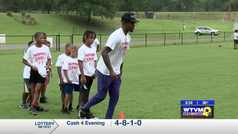 Phenix City football alums return to give back