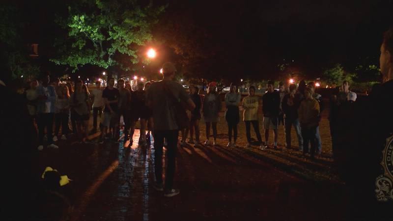 A crowd gathered on Auburn University's Samford lawn for a vigil to missing Aniah Blanchard.