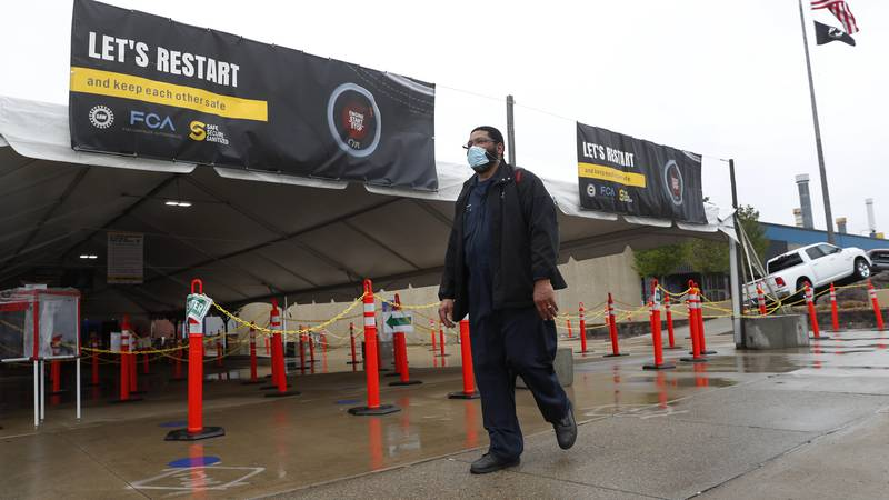 United Auto Workers members leave the Fiat Chrysler Automobiles Warren Truck Plant after the...