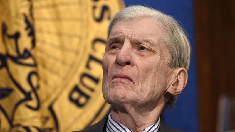 FILE - Former Virginia Sen. John Warner, also a former Navy secretary, listens as Chief of...