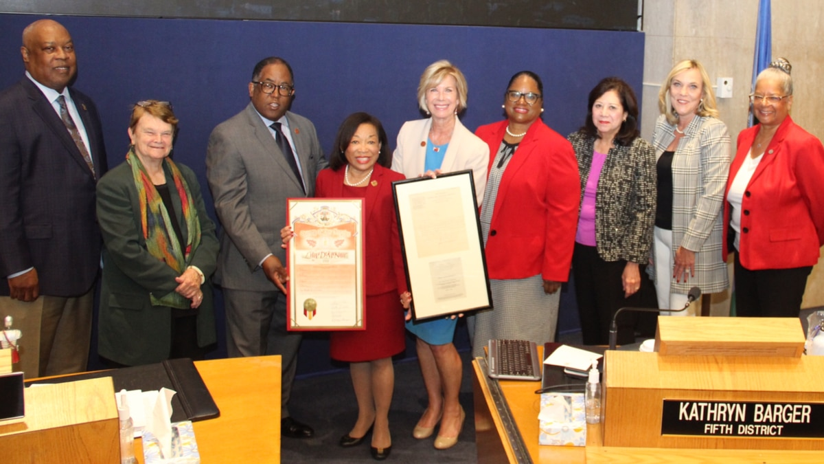 President McNair (center, left) and Supervisor Janice Hahn (center, right) are joined by (left...