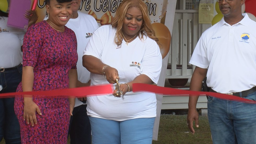 Jackie cutting the ceremonial ribbon