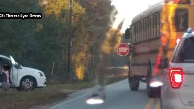 Driver snaps a photo of what appears to be a Lee County School District school bus stopping...