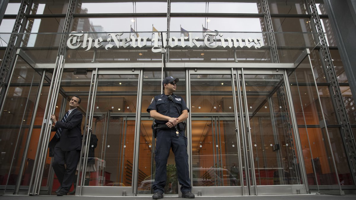 FILE - In this June 28, 2018, file photo, a police officer stands outside The New York Times...