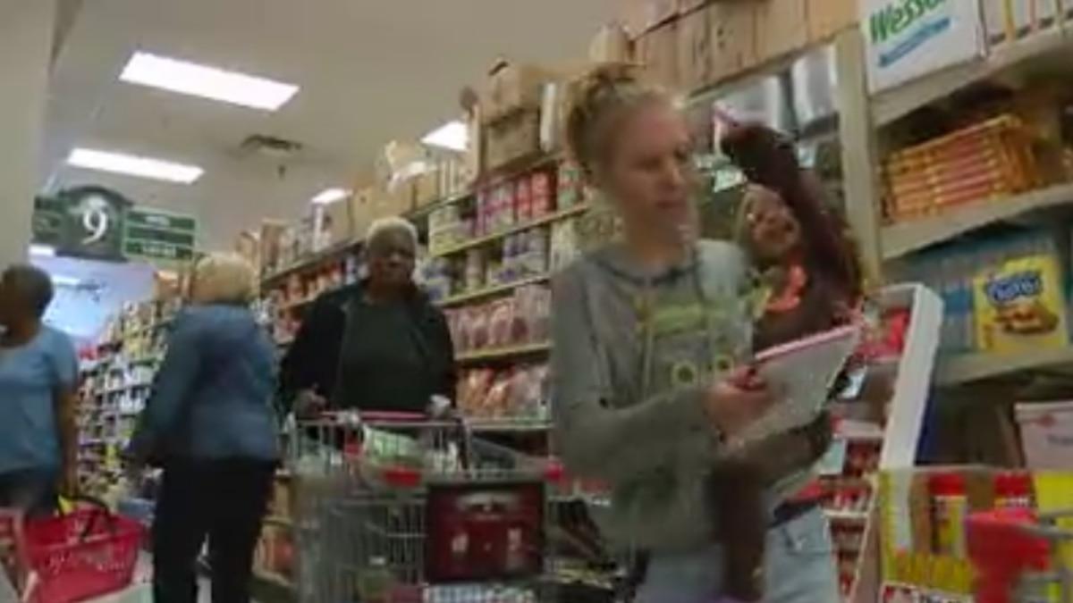 Emily Tedder and her family shopping for Thanksgiving