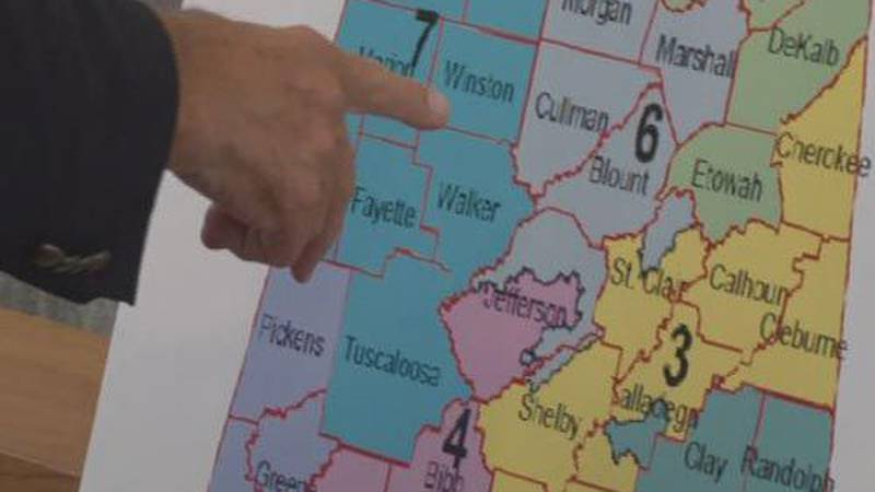 A representative points to a map of Alabama during the redistricting hearings May 12th.