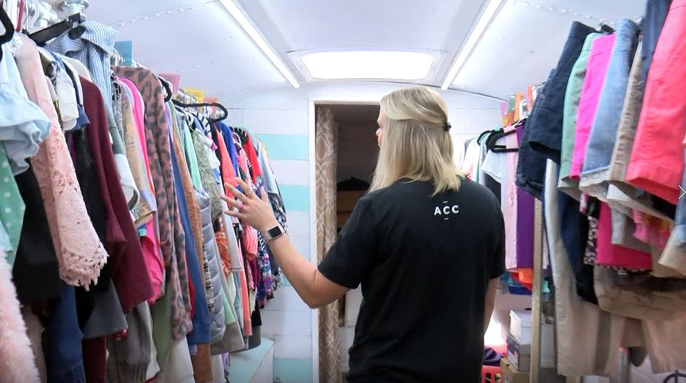 The once empty bus is now filled with thousands of clothing items, from shirts and pants to...