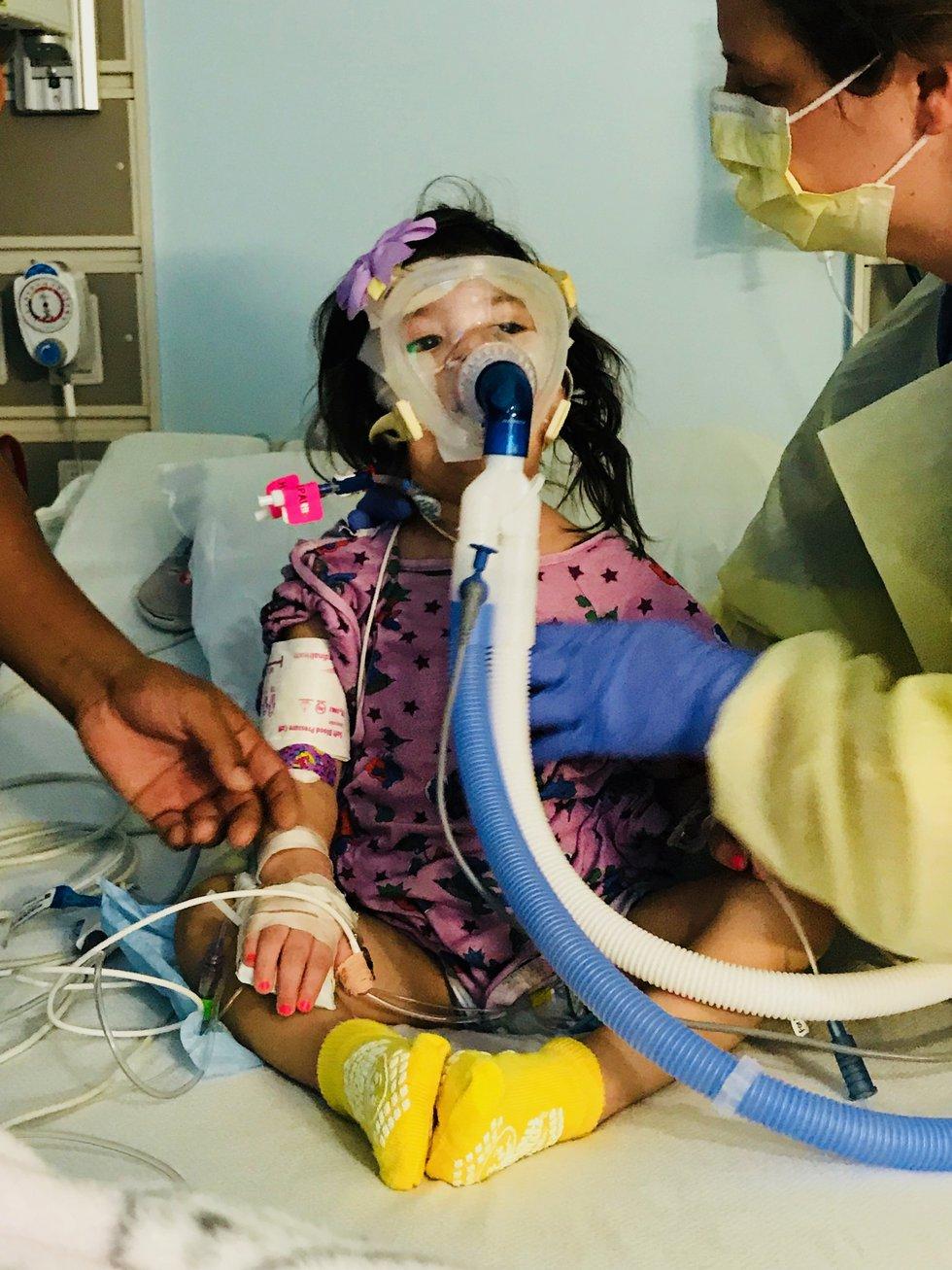 Abigail pictured on a ventilator, undergoing care in ICU at Children's Healthcare of Atlanta.