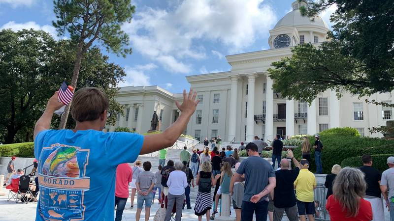 Freedom protection rally attendees hold a church service on the steps of the Capitol.