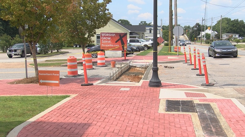 Opelika city officials have made it their mission to make all sidewalks and government...