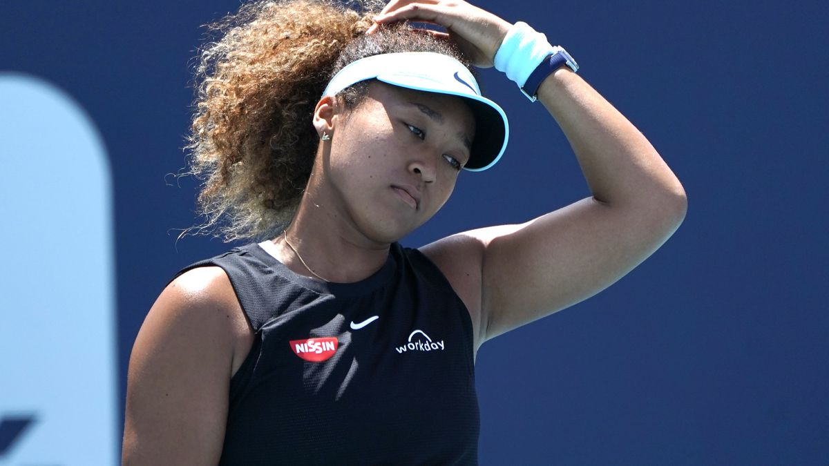 FILE - Naomi Osaka, of Japan, reacts during her match against Maria Sakkari, of Greece, in the...