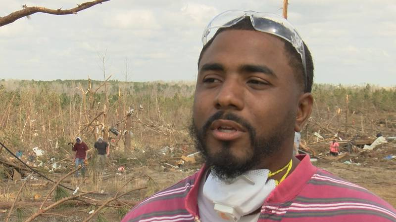 CJ Battle returned to Lee County where he grew up to help clean up after the tornadoes.