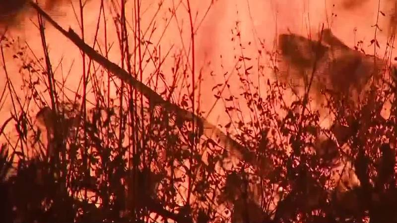 Cooler weather and even some rain helped in the battle against some of the largest blazes but...