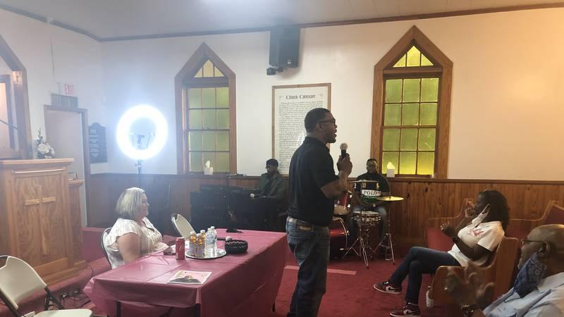 Pastor Terrell Hagood talks to youth at Emmanuel Missionary Baptist Church .